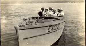 Frank Dodson seated in a speed boat called the 'Eagle'.ca.1913