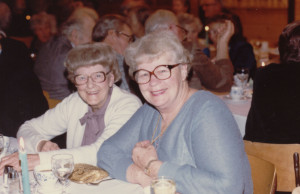 Evelyn Paton and Lulu Renwick sit together at a table at the Legion Christmas Party. ca. 1980