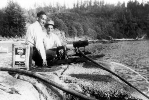 : Fred Taylor and Joe Inneichen operating a water pump while fighting a fire at Tunstall Bay. ca. 1940's