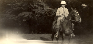 "George Cowan on his horse ""Maxine"" at Cowan's Point. ca. 1920"