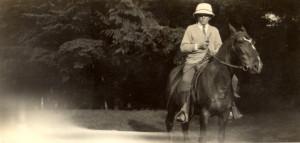 "George Cowan on his horse ""Maxine"" at Cowan's Point. ca. 1920"