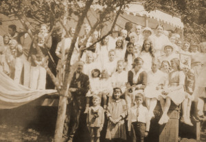 Print of photo of a large group of people at Cowan Point for a Sunday gathering. Families there include the Malkin, Rogers, Cowan, Molson. ca. 1930's