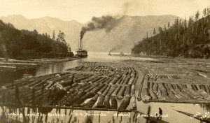 "Terminal Steam Navigation Co. steamer ""Baramba"" entering Snug Cove with log booms in the foreground. ca.1910"